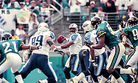 Steve McNair, #9, looks for a receiver during the NFL AFC Championship game, which the Tennessee Titans won over the Jacksonville Jaguars 33-14 on January 23, 2000 in Jacksonville, FL.  (Photo by Brian Cleary/bcpix.com)