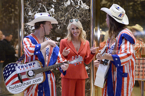 "Kellyanne Conway, campaign manager and strategist, is seen in the lobby of the Trump Tower with the ""Naked Cowboy"" themed performers in New York, New York, on November 28, 2016.<br /> Credit: Anthony Behar / Pool via CNP"