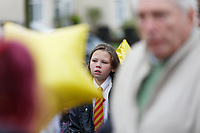 Pictured: A young girl outside St John Lloyd School, in Llanelli, Carmarthenshire, UK. Thursday 12 September 2019<br /> Re: The family of a bullied pupil were joined by friends and held a minute's silence, a year after he hanged himself in school toilets.<br /> His heartbroken father Byron John claims his son Bradley, 14, would still be alive if the school had acted to stop the bullies.<br /> Bradley's 13-year-old sister Danielle found him dead in the toilet block at, an hour after going missing at St John Lloyd Roman Catholic School in Llanelli, South Wales, UK.