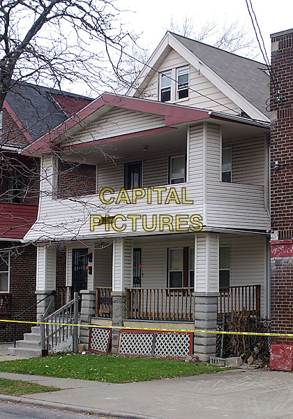 ATMOSPHERE .The residence of 50-year-old convicted rapist and alleged serial killer ANTHONY SOWELL is sealed off with police tape. A US judge on November 4, 2009 charged Sowell with five counts of murder and refused him bail as investigators examined the gruesome remains of up to 11 victims found at his Cleveland home. People in the neighborhood believed the strong odor in the areacame from a sausage shop on the corner, Cleveland, Ohio, USA.     .November 15th, 2009         .gv general view crime criminal house home police tape           .CAP/ADM/JN.©Jason L Nelson/AdMedia/Capital Pictures.