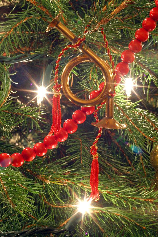 Brass horn ornament on Christmas tree