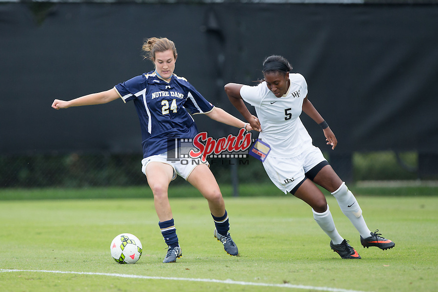 Katie Naughton (24) of the Notre Dame Fighting Irish battles to keep the ball away from Jenai Davidson (5) of the Wake Forest Demon Deacons at Spry Soccer Stadium on September 28, 2014 in Winston-Salem, North Carolina.  The Fighting Irish defeated the Demon Deacons 1-0.   (Brian Westerholt/Sports On Film)