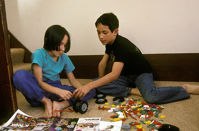 Berkeley CA Latino siblings working on Knex building project together