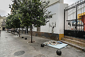 Matress and bedding belonging to a homeless person in a side street behind the bull ring, Seville, Spain.