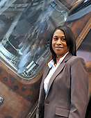 Jeannette Epps, a member of the Astronaut Class of 2009, poses for a photo in front of the Apollo 11 Command Module that flew to the Moon 40 years ago at the National Air and Space Museum in Washington, D.C. on Friday, July 17, 2009.<br /> Credit: Ron Sachs / CNP