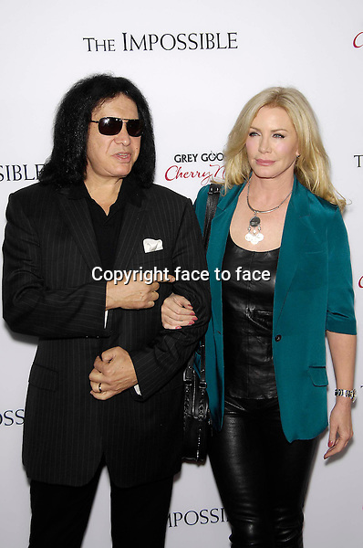 Gene Simmons and Shannon Tweed during the premiere of the new movie from Summit Entertainment THE IMPOSSIBLE, held at Arclight Cinerama Dome, Los Angeles, California, 10.12.2012...Credit: StarMaxInc/face to face..- Spain, Hungary, Bulgaria, Croatia, Russia, Romania and Moldavia, Slovakia, Slovenia, Bosnia & Herzegowina, Serbia, Ukraine and Belaurus, Lithuania, Latvia and Estonia, Australia, Taiwan, Singapore, China, Malaysia and Thailand rights only -
