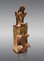 Hittite terra cotta tower shaped vessel representing a two storey tower of the city walls complete with merlons - 14th century BC - Hattusa ( Bogazkoy ) - Museum of Anatolian Civilisations, Ankara, Turkey . Against gray background