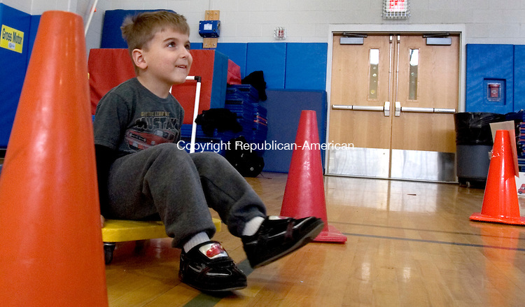 TORRINGTON, CT. 10 March 2012-031012SV04-Keith Carnaroli, 4, of Torrington tries a floor exercise during the kindergarten readiness fair at the Torringford School in Torrington Saturday. The event was for families with a child about to start Kindergarten. The future students had the opportunity to meet their principal, take home information and participate in activities. This is the fifth year the fair has taken place. Just over 100 students attended..Steven Valenti Republican-American