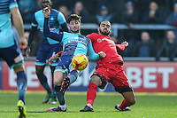Joe Jacobson of Wycombe Wanderers  and Paul McCallum of Leyton Orient (10) battle for the ball during the Sky Bet League 2 match between Wycombe Wanderers and Leyton Orient at Adams Park, High Wycombe, England on 17 December 2016. Photo by David Horn / PRiME Media Images.