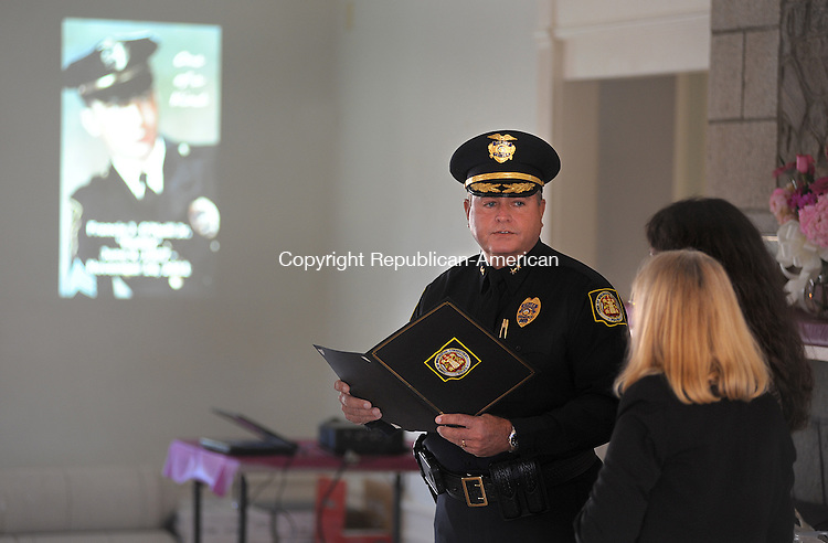 """WINSTED  CT, 19 FEBRUARY  2012-021912JS05-Winsted Police Chief Robert M. Scannell presents a proclamation to Barbara O'Neill, the wife of the late Captain Francis J. """"Buddy"""" O'Neill, Jr., and his daughter Deb O'Neill of Helena, Montana during a memorial service Sunday at the Knights of Columbus hall in Winsted. Francis O'Neill, Jr., who was a member of the Winsted Police Department for 28 years, died November 16, 2011. .Jim Shannon Republican-American"""