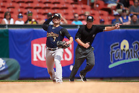 Scranton/Wilkes-Barre RailRiders third baseman Pete Kozma (7) throws to first as umpire Sean Ryan signals fair ball during a game against the Buffalo Bisons on July 2, 2016 at Coca-Cola Field in Buffalo, New York.  Scranton defeated Buffalo 5-1.  (Mike Janes/Four Seam Images)