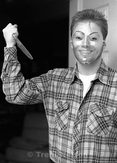 Ted Hansen with mask and knife.<br />