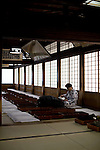A man relaxes on the 2nd floor rest area inside Dogo Onsen, thought to be Japan's oldest spa in Matsuyama City, Ehime Prefecture, Japan on 20 Feb. 2013.  Photographer: Robert Gilhooly