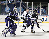 Matt Ginn (HC - 35), Justin Breton (Bentley - 3), Joe McNamara (HC - 4) - The Bentley University Falcons defeated the College of the Holy Cross Crusaders 3-2 on Saturday, December 28, 2013, at Fenway Park in Boston, Massachusetts.