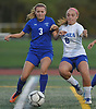 Nicole Devlin #8 of Calhoun, right, and Katie Winter #3 of Port Washington battle for possession during the Nassau County varsity girls soccer Class AA semifinals at Cold Spring Harbor High School on Monday, Oct. 30, 2017. Devlin scored a goal in Calhoun's 3-0 win.