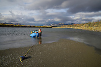 Georgia Bennett secures her raft before hiking to Kuirzinjik Lake (Lobo Lake) along the the Sheenjek River,in Alaska's Arctic National Wildlife Refuge in late August. MR