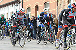 The chasing pack of riders including Fabian Cancellara (SUI) Radioshack Leopard Trek pass over the cobbles of Paddestraat in Zottegem  during the 56th edition of the E3 Harelbeke, Belgium, 22nd  March 2013 (Photo by Eoin Clarke 2013)