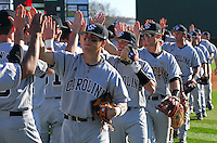 University of South Carolina players exchange high fives at the end of a game between the Clemson Tigers and USC Gamecocks on March 2, 2008, at Doug Kingsmore Stadium in Clemson, S.C. The Gamecocks won 5-1.   Photo by: Tom Priddy/Four Seam Images