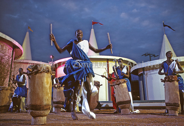 African Pavillion, 1964 World's Fair, Flushing Meadows, New York. A troupe of seven foot tall Watusi warriors and a dozen drummers, the personal performers of King Mwambutsa of Burundi, dance a victory celebration. Photo by John G. Zimmerman.