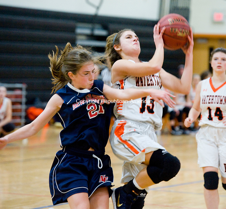 WATERTOWN, CT-011118JS06---Watertown's Brianna Nolan (13) gets fouled by New Fairfield's Sydney O'Connor (21) while driving to the basket during their non-league game Thursday at Watertown High School.<br />  Jim Shannon Republican-American
