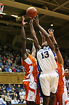 21 December 2007: Duke's Karima Christmas (13) goes up for a shot defended by  Bucknell's Hope Foster (l) and Cosi Higham (r). The Duke University Blue Devils defeated the Bucknell University Bisons 92-49 at Cameron Indoor Stadium in Durham, North Carolina in an NCAA Division I Women's College Basketball game.
