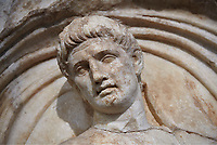 Close up of a Roman Sebasteion relief  sculpture of a prisoner of  Emperor Claudius as God of sea and land,  Aphrodisias Museum, Aphrodisias, Turkey.  Against a grey background.<br /> <br /> The Emperor as god Claudius strides forward in a divine epiphany, drapery billowing around his head. He receives a cornucopia with fruits of the earth from a figure emerging from the ground, anda ship&rsquo;s steering oar from a marine tritoness with fish legs. The idea is clear: the god-emperor guarantees the prosperity of land and sea. The relief is a remarkable local visualisation - elevated and panegyrical - of the emperor&rsquo;s role as a universal saviour and divine protector.