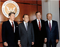 ***FILE PHOTO*** George H.W. Bush Has Passed Away<br /> United States President George H.W. Bush, right center, joins former U.S. Presidents Ronald Reagan, left, Richard M. Nixon, left center, and Gerald R. Ford, right at the dedication of the Richard Nixon Library and Birthplace in Yorba Linda, California on Thursday, July 19, 1990.  CAP/MPI/RS<br /> &copy;RS/MPI/Capital Pictures