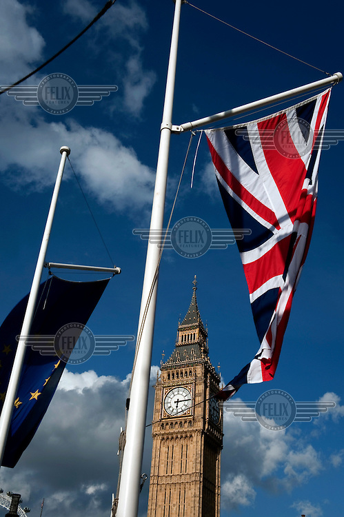 The Union Jack and the flag of the European Union fly in front of The Clock Tower at the House of Commons in Westminster, London. Although the tower is popularly referred to as Big Ben, this is actually the nickname of the bell housed within whose official name is the Great Bell.