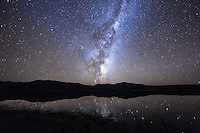 Lake Tekapo is part of the Aoraki Mackenzie International Dark Sky Reserve. This is a gold-rated dark sky reserve, in recognition of the quality of the almost light pollution-free skies of the Mackenzie Basin in New Zealand. I recently shot this image of the galactic core of our Milky Way rising behind the mountains and reflecting in Lake Tekapo.