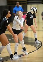 NWA Democrat-Gazette/ANDY SHUPE<br /> Bentonville's Kloey Eakin (center) digs a ball alongside Trinity Hamilton Tuesday, Sept. 10, 2019, during play against Van Buren in Tiger Arena in Bentonville. Visit nwadg.com/photos to see more photos from the match.