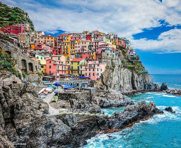 Manarola and its small  harbor carved into the Italian Riviera's craggy coast. Cinque Terre, Italy.