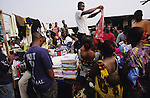 TOWNSHIP LIFE, Ivory Coast. Market. Yopougon, near Abidjan. West Africa. A  huge  sprawling township across the lagoon from the capital. It has a population of over a million. Yopougon has been the site of numerous massacres, a flash point, problems between Muslims and Christians. Residents are often poor and living in shanties.