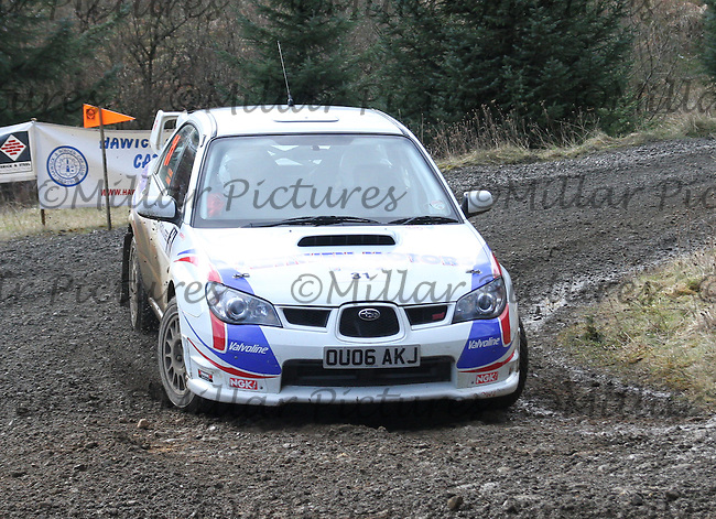 Martin Craik - Steven Brown in a Subaru Impreza at Junction 8 on Special Stage 5 Buck Fell on the Brick & Steel Border Counties Rally 2014, Round 2 of the RAC MSA Scottish Rally Championship sponsored by ARR Craib Transport Limited and other championships  and organised by Whickham & District and Hawick & Border Car Clubs and based in Jedburgh and held in Kielder Forest on 22.3.14.