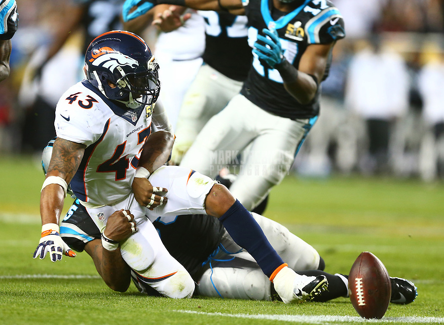Feb 7, 2016; Santa Clara, CA, USA; Denver Broncos safety T.J. Ward (43) fumbles the ball after recovering a fumble against the Carolina Panthers in Super Bowl 50 at Levi's Stadium. Mandatory Credit: Mark J. Rebilas-USA TODAY Sports