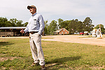 April 20, 2016. Rowland, North Carolina. <br />  Bo Stone stands near the equipment shed of his 2300 acre farm. The farm has 2 full time employees, and hires on temporary workers during the busy seasons.<br />  Bo Stone, age 44, runs a 2300 acre farm near the South Carolina border. After 5 generations of tobacco farming, Stone helped to move his family farm over to corn, wheat, soybeans, and strawberries 7 years ago. <br />  While his corn crop is entirely made up of stacked genetically modified strains of corn, Stone says he chose the varieties primarily for their yield characteristics, but having the ability to utilize their herbicide tolerant traits if a weed gets out of control is &quot;another tool in my toolbox&quot;.