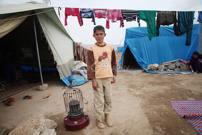 ARBAT, IRAQ: Luay Wazer, 9, from Derzor, Syria, is pictured in a refugee camp in Arbat, Iraq. ..The semi-autonomous region of Iraqi Kurdistan has accepted refugees from the conflict in Syria into several camps. Arbat lies near Sulaimaniyah in northeastern Iraq, approximately 500 kilometres from the Syrian border...Photo by Besaran Tofiq/Metrography