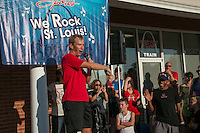 Fleet Feet St. Louis owner David Spetnagel introduces Meb Keflezghi at the Run with Meb promotion at the Des Peres store, Wednesday, September 3, 2014.