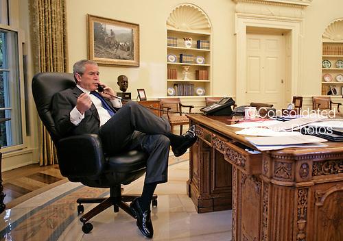 Washington, D.C. - June 8President George W. Bush talks with the Prime Minister Nouri al-Maliki of Iraq regarding the death of terrorist Abu Musab al-Zarqawi from the Oval Office Thursday morning, June 8, 2006..Credit: Eric Draper - White House via CNP.