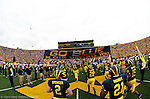 The Michigan Football team rush out on to the Michigan Stadium field before the Wolverines 30-17 victory over Iowa on Saturday, September 25, 2004 in Ann Arbor, Mich. (Photo by TONY DING / Daily)