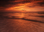 Sunset nature scenery of lake Huron with beautiful dramatic bright red sky. Ontario, Canada.