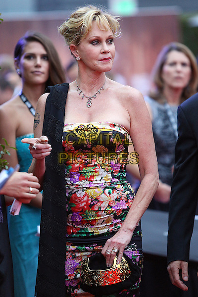 Melanie Griffith.Children's Hospital Los Angeles Gala: Noche de Ninos, Los Angeles, California, USA, 20th October 2012..half length strapless floral print red pink black dress necklace scarf over shoulder  clutch bag gold .CAP/ADM/PH.©Paul A. Hebert/AdMedia/Capital Pictures.
