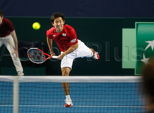 05.03.2016. Barclaycard Arena, Birmingham, England. Davis Cup Tennis World Group First Round. Great Britain versus Japan. Yoshihito Nishioka of Japan serves during the doubles match between Great Britain's Andy Murray and Jamie Murray and Japan's Yoshihito Nishioka and Yasutaka Uchiyama on day 2 of the tie.  GB won in straight sets 6-3, 6-2, 6-4.