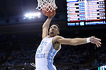 30 December 2014: North Carolina's J.P. Tokoto dunks the ball. The University of North Carolina Tar Heels played the College of William & Mary Tribe in an NCAA Division I Men's basketball game at the Dean E. Smith Center in Chapel Hill, North Carolina. UNC won the game 86-64.