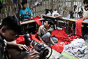Teenage boys from the Chowduli class are seen working at a tailoring shop in Chaymalpur village of North 24 Parganas in West Bengal, India. Photo: Sanjit Das/Panos for The Wall Street Journal. Slug: ICASTE