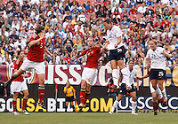 22 MAY 2010:  USA's Abby Wambach #20 heads the ball during the International Friendly soccer match between Germany WNT vs USA WNT at Cleveland Browns Stadium in Cleveland, Ohio. USA defeated Germany 4-0 on May 22, 2010.