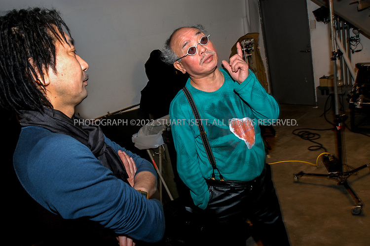 2/18/2003--Tokyo, Japan<br /> <br /> Famed Japanese photographer, Nobuyoshi Araki, at work in a studio. Japan's most famous photographer Nobuyoshi Araki, 62, is a controversial artist obsessed with rendering women, his one constant focus, as objects. After four decades of prolific output, continual growth and exploration, focused mainly on nudes, flowers his cat and mournful skies, few critics in Japan dispute the artist's appraisal of himself as Tensai Araki, or Araki the Genius. After more that 300 published books, four or five major shows in Japan every year and frequent overseas shows, he is not slowing down nor is he getting bored with his most cherished subject matter, the female form. The photographs of his wife Yoko, who died in 1990, have established his reputation in Japan. Of her he says: photographing her was everything to me. I shot her more than any other woman, and she was my most exciting subject.<br /> <br /> All photographs &copy;2003 Stuart Isett<br /> All rights reserved<br /> This image may not be reproduced without expressed written permission from Stuart Isett.