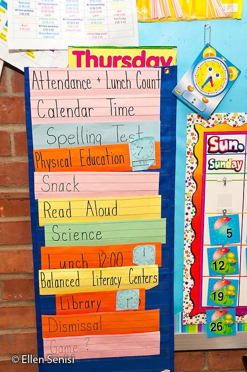 Schenectady, New York. Zoller Elementary School (urban public school). First Grade Inclusion class.  Class schedule for the day on bulletin board in classroom. ID: AJ-g1b. ©Ellen B. Senisi