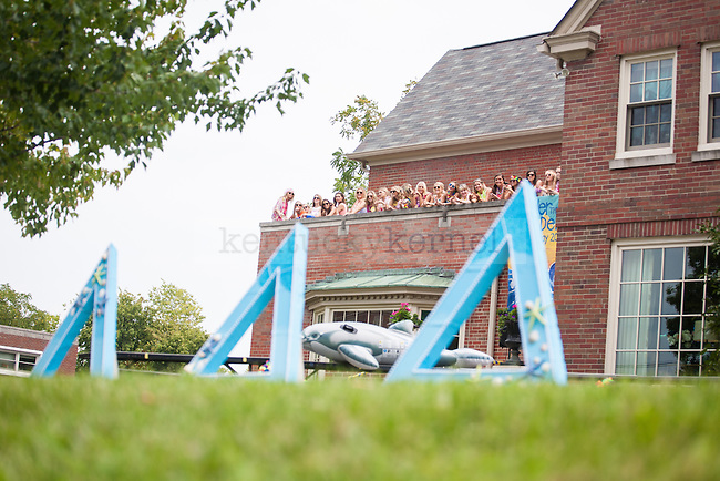 Sisters of the Delta Delta Delta sorority wait for their new members during UK's sorority bid day in Lexington, Ky., on Friday, August 22, 2014. Photo by Adam Pennavaria | Staff