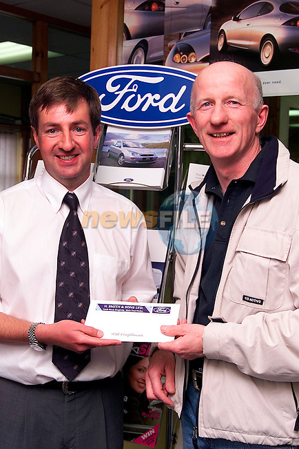 Joseph Griffen who won a holiday voucher for £2001 in a used car promotion in association with Smiths of Drogheda being presented with his prize from Nicky Smith..Picture: Paul Mohan/Newsfile