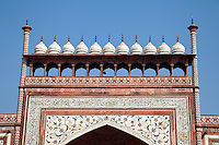 Agra, India.  Taj Mahal.  Decorative Domes on top of the Gateway Entrance opening to the Taj and its Gardens.  Calligraphy and Floral Design.